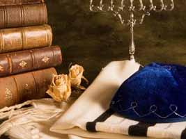 Kippa, torah chumash books, tallis, and Hannukia menorah
