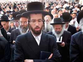 A crowd of orthodox jewish men