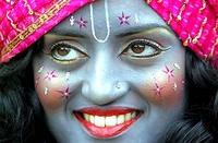 girl dressed as krishna.jpg