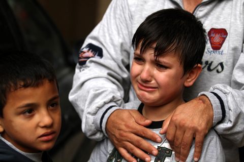 A Christian child weeps for his slain family