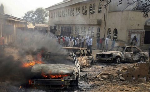 Church windows are shattered after a Boko Haram car bombing