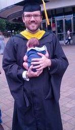 N holding Trin at graduation 2