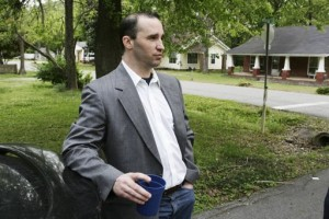 Everett Dutschke waits for federal authorities to search his home in Tupelo