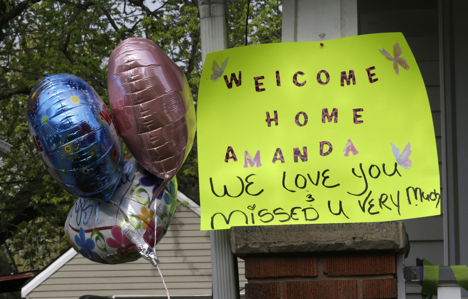 A sign hangs on the porch of the home of Amanda Berry Wednesday, May 8, 2013