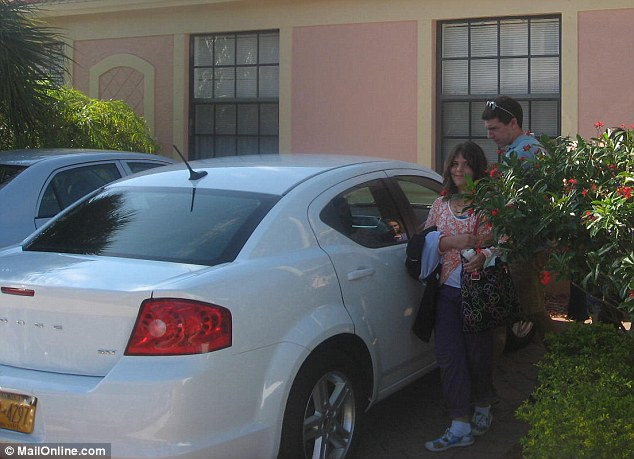 Barbara Knight's 10-year-old daughter is seen outside their home in Florida before they leave for Ohio