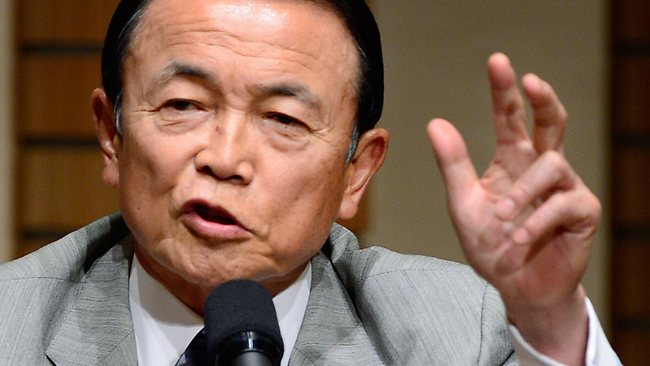 Japan's Finance and Deputy Prime Minister Taro Aso gestures as he delivers a speech in Tokyo on June 28