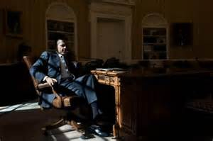 Obama in Sitting Silently in the Dark Shadows of His Protected Oval Office