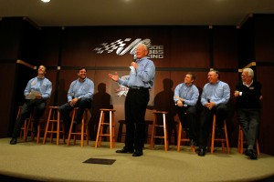 Norm Miller (far right) and Joe Gibbs (standing) during the 2011 Sprint Media Tour (Photo courtesy NASCAR Media)