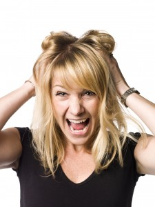 Portrait of a woman making a crazy face