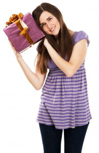 Young beautiful woman with a gift box