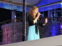 "Jodi sings at Disney's ""Night of Joy."""