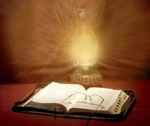 open Bible with reading glasses and hurricane lamp inspirational photo by Steve Henderson Fine Art