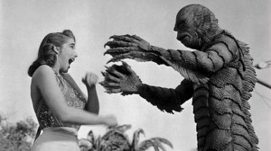 We're told that it's all harmless fun, but much of what mass media pipes into our minds affects the way we think. So who's making this stuff? Image clip from 1954 movie Creature from the Black Lagoon