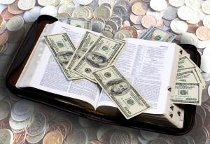 Photo of 100 dollar bills money draped over Bible verses by Steve Henderson Fine Art