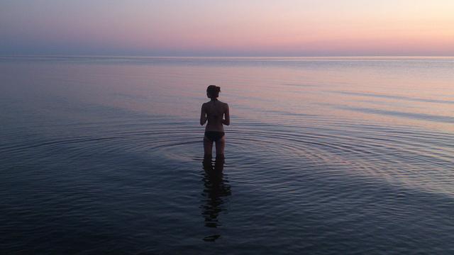 Helmuts Guigo_Evening swim_Calm Baltic sea after the sunset