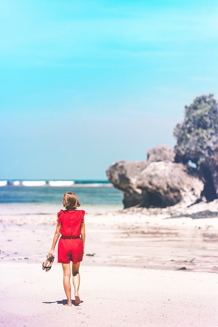 woman-holding-sandals-in-the-shore-1126037 A