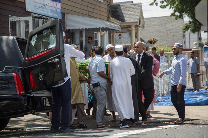 The funeral prayers for the two slain men drew hundreds of mourners. Credit Christopher Lee for The New York Times