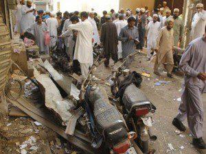 People inspect the blast site in Aram Bagh area of Karachi. PHOTO: AFP