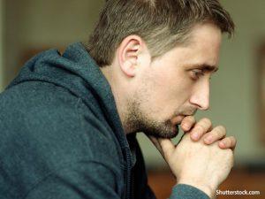 Faith-man-praying-church