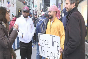 Photo Credit: Free Trip to Egypt. Activists, filmmaker Tarek Mounib (R) and YouTube celebrity Adam Saleh, make an intriguing offer to strangers in NYC.