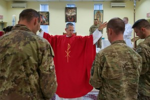 US Army Chaplain Paul Hurley, a Catholic priest, says mass for the troops at a Military base in Kabul, Afghanistan. Photo courtesy of Journey Films