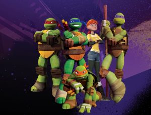 Pictured: Raphael (red mask), Leonardo (blue mask), April (red hair), Donatello (purple mask) and Michelangelo (orange mask), in TEENAGE MUTANT NINJA TURTLES on Nickelodeon. Photo: Nickelodeon. ©2012 Viacom, International, Inc. All Rights Reserved